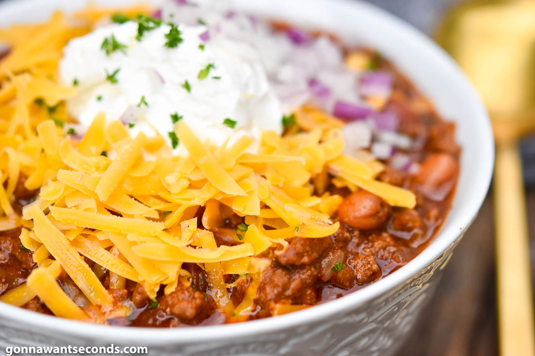 instant pot chili with toppings, in a white bowl