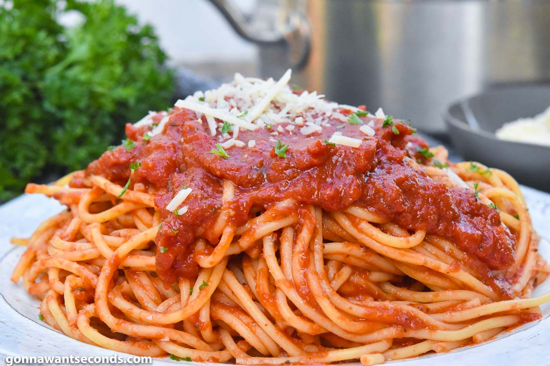 Spaghetti Recipes, Italian spaghetti topped with cheese, on a plate