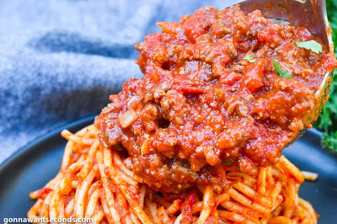 Spaghetti Sauce poured over spaghetti pasta