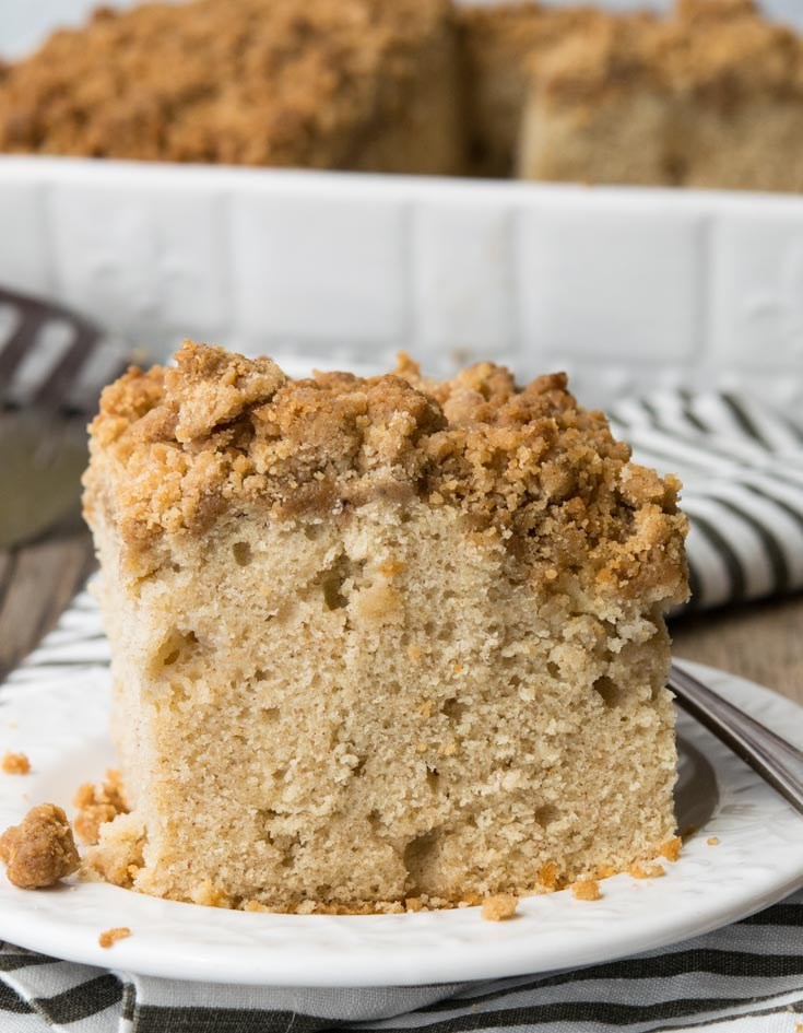 A slice of Apple Coffee Cake with fork on a saucer
