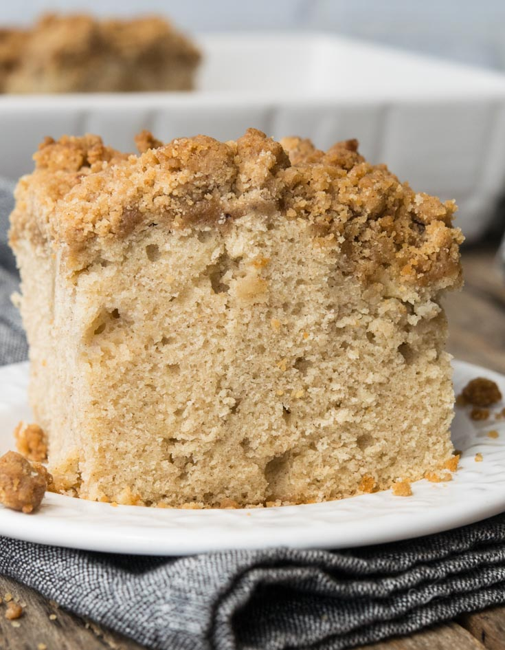 A slice of Apple Coffee Cake on a saucer