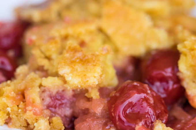 Cherry Pineapple Dump Cake on a saucer