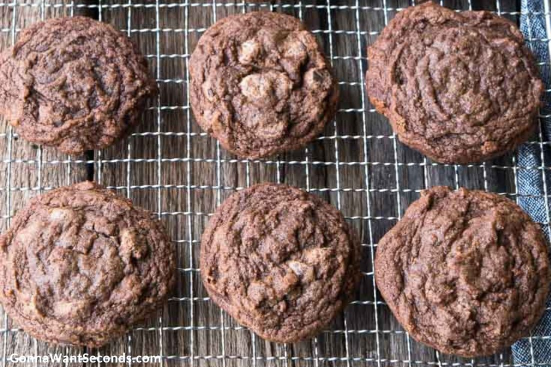 chocolate chocolate chip cookies on a cooling rack
