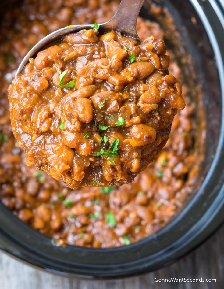 Ladle scooping Crockpot Baked Beans from the crockpot