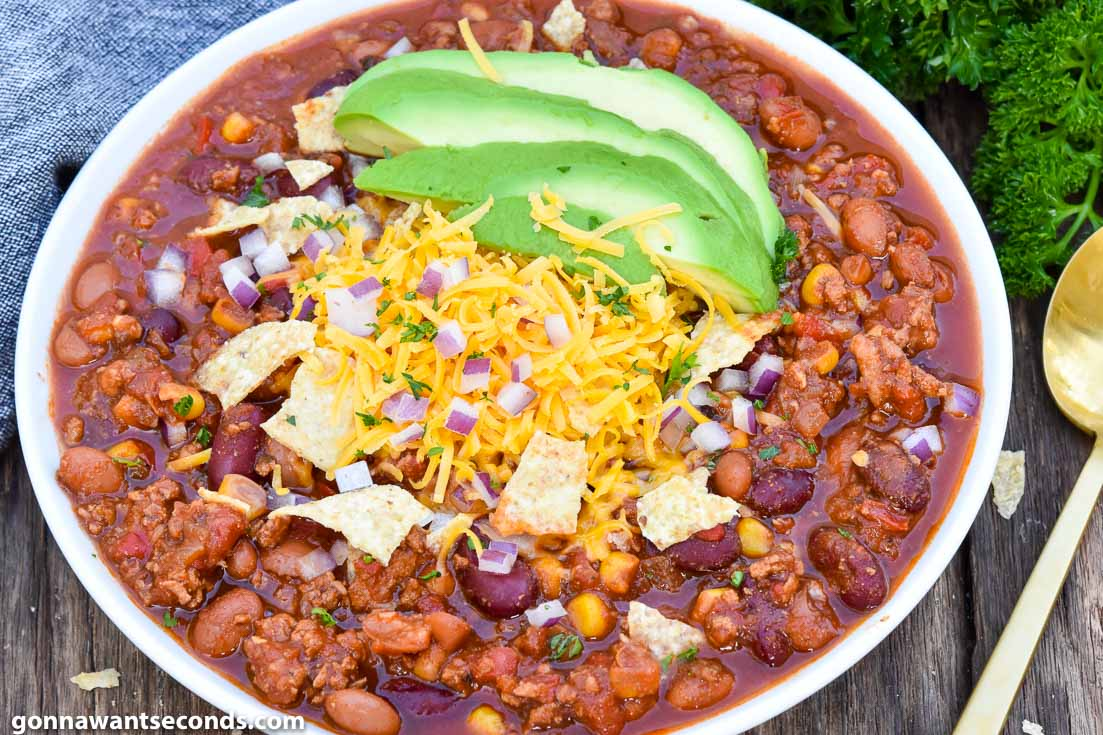 Instant pot turkey chili with toppings, on a bowl