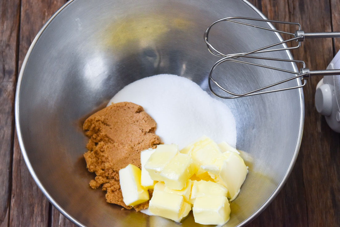 how to make soft chocolate chip cookies. sugar and butter in a mixing bowl