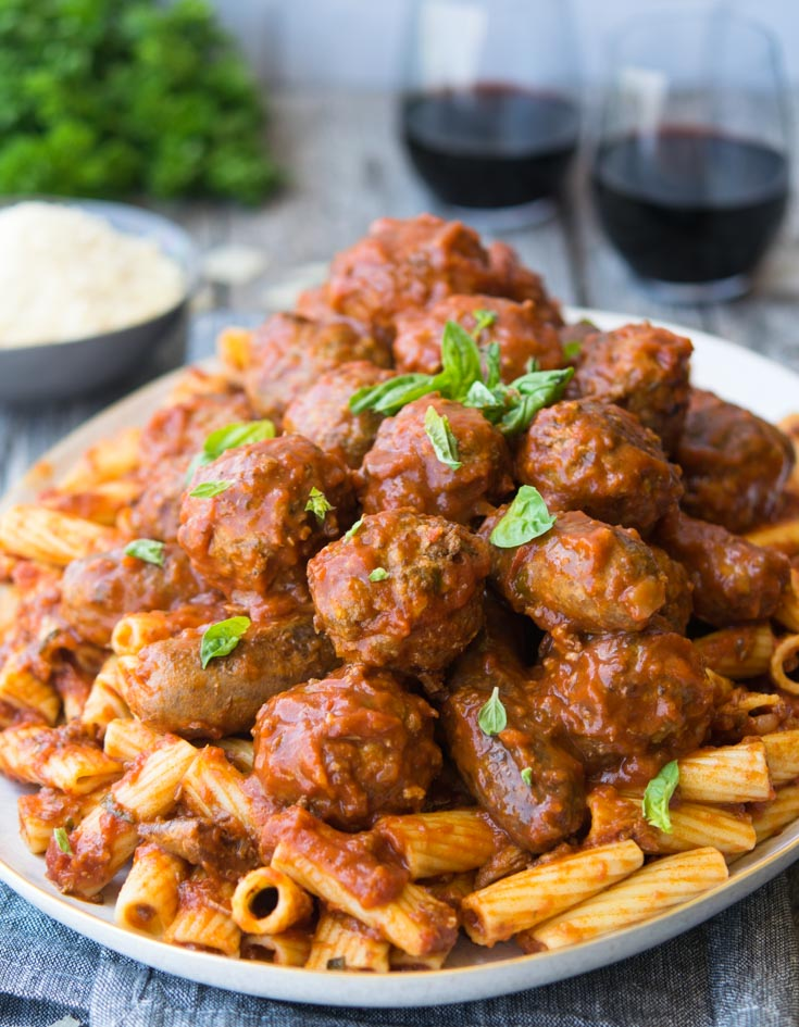 A plateful of pasta topped with Italian Sunday Gravy and meatballs