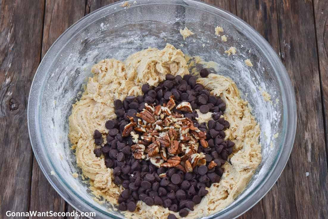 how to make Toll House cookies, adding pecans and morsels into the dough