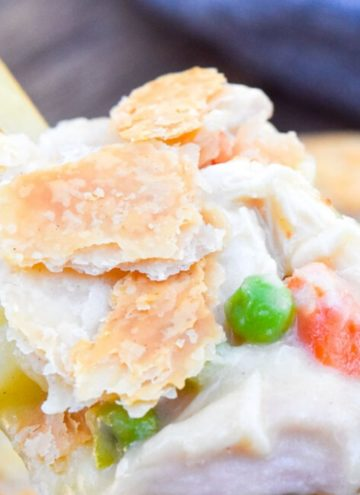 Scooping KFC chicken pot pie filling