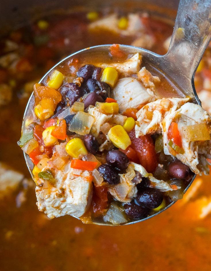 Scooping a ladleful of Mexican Chicken Soup in a pot