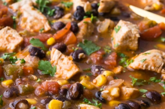 Mexican Chicken Soup in a bowl with spoon