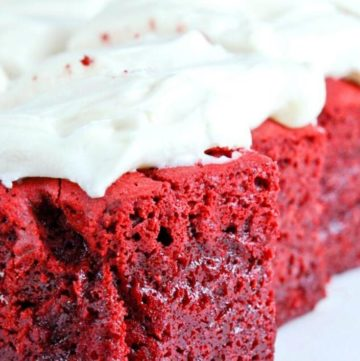 Slices of red velvet brownies with cream cheese frosting