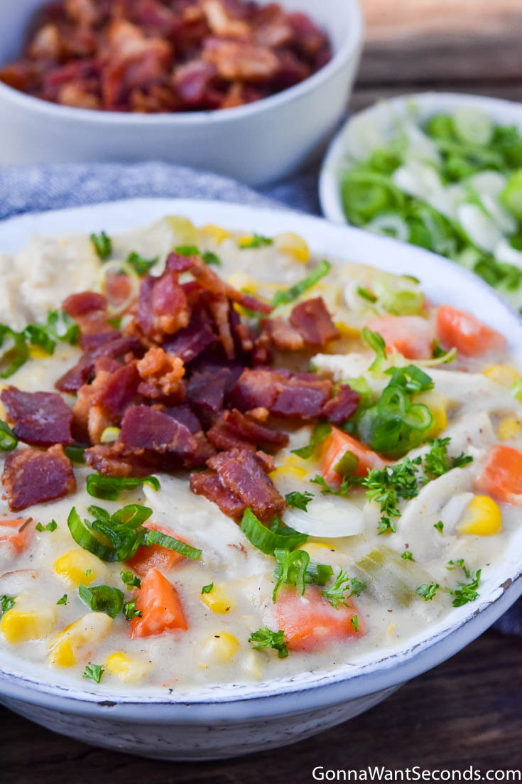 Chicken corn chowder topped with bacon bits in a bowl