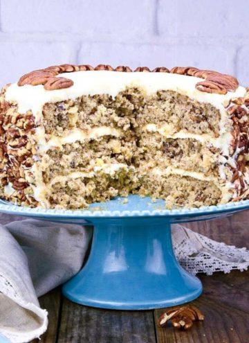 Whole hummingbird cake on a blue cake stand