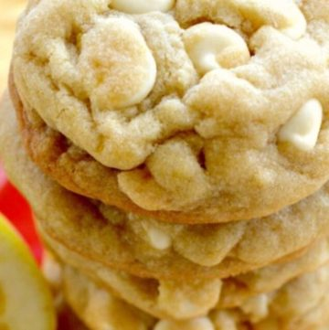 Lemon white chocolate chip cookies stack on top of each other