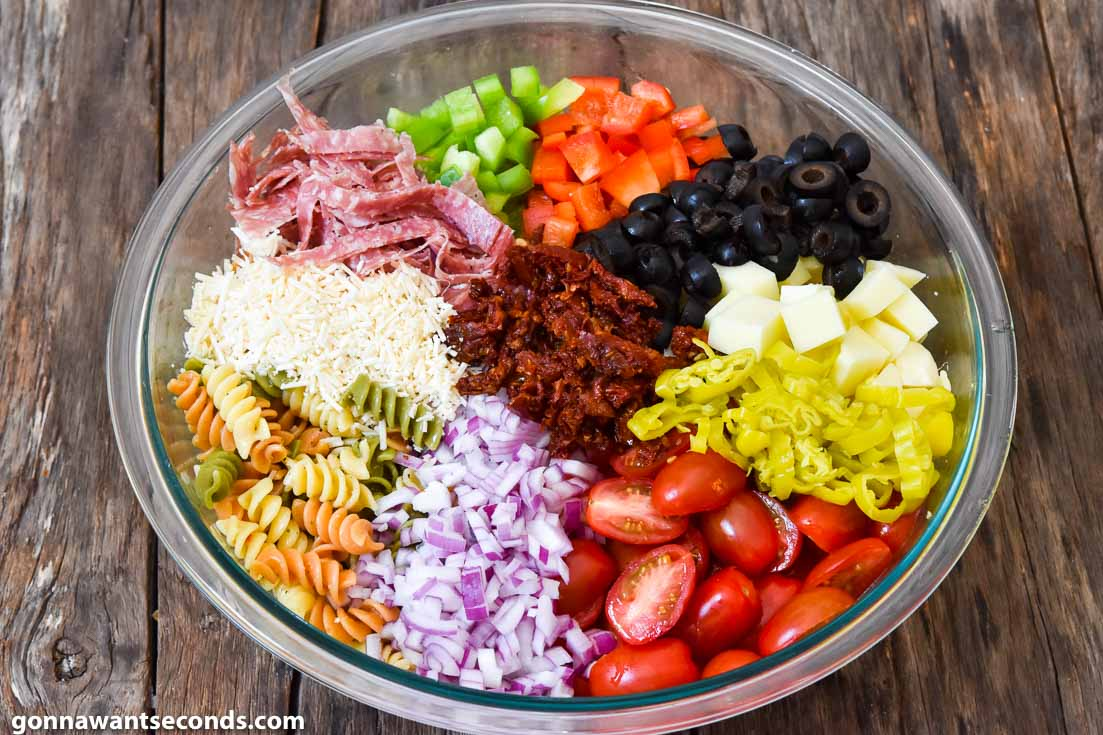 How to make Pasta Salad with Italian Dressing, adding remaining ingredients to the pasta mixture