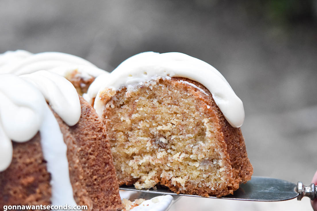 A slice of Banana Pound Cake from the whole cake