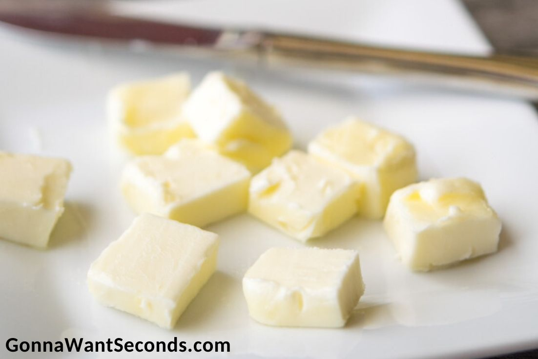 cubed butter on a chopping board