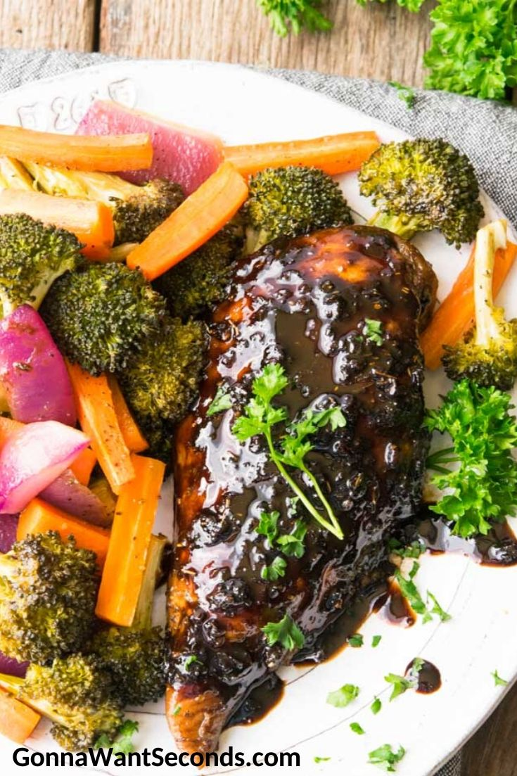 Honey Balsamic Chicken with broccoli, carrots, and onions on a plate