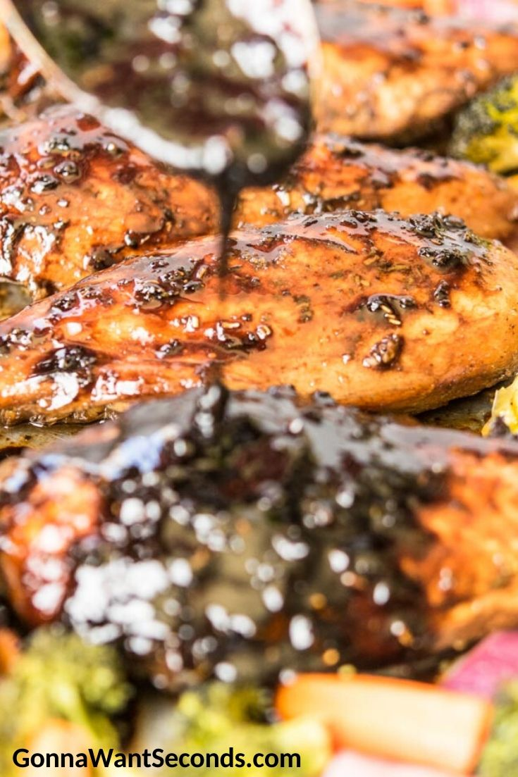How to make Honey Balsamic Chicken, drizzling marinade over chicken