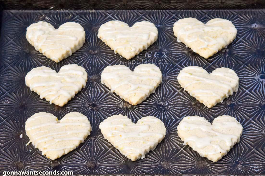 Heart shaped Lemon Sugar Cookies on a baking sheet