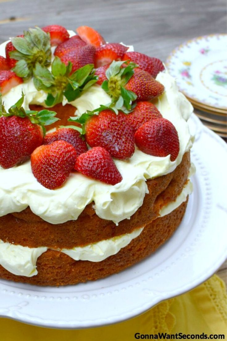Whole Strawberry Cream Cake topped with fresh strawberries