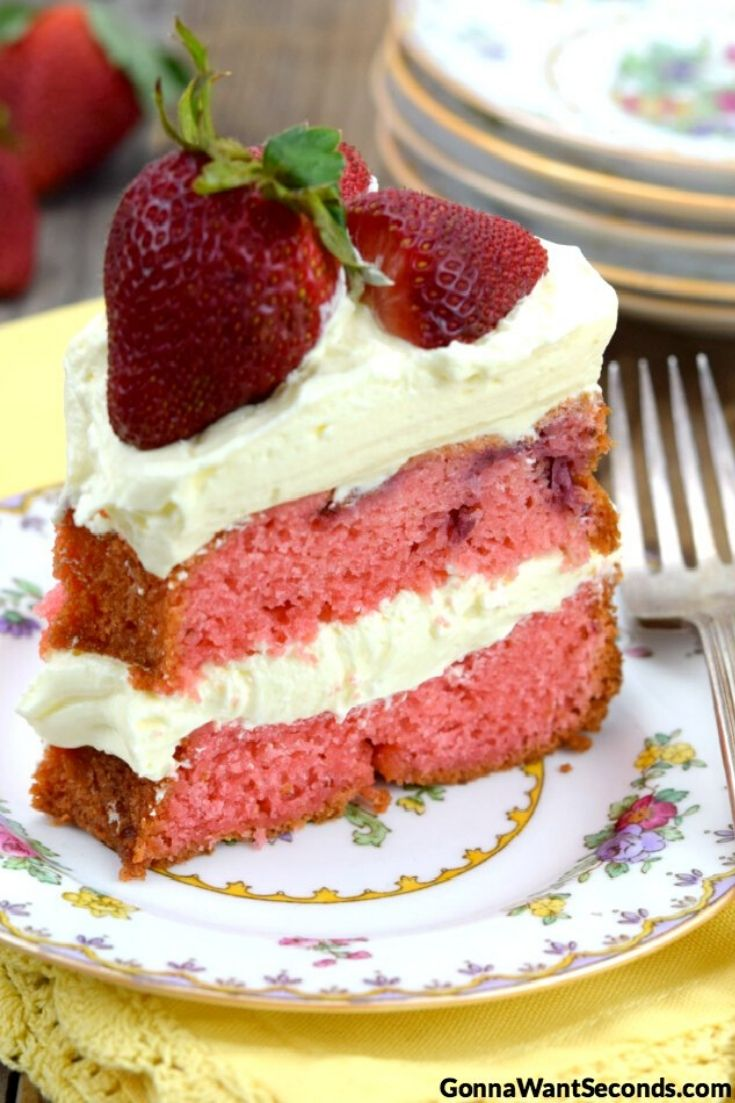 A slice of Strawberry Cream Cake topped with fresh strawberries