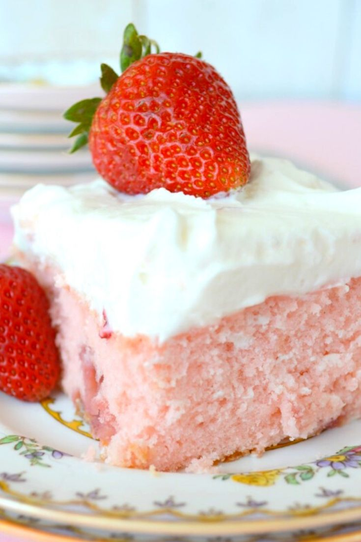 A slice of Strawberry sheet cake on a plate