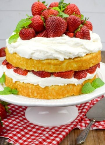 Strawberry Shortcake Cake on a cake stand