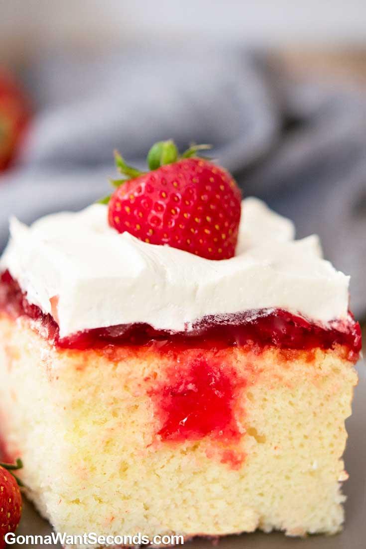 A slice of Strawberry Poke Cake on a plate