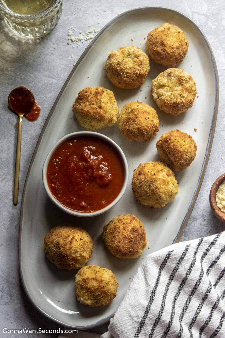 Air fryer arancini recipe on a platter with dip