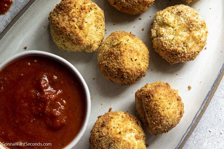 close up of Air fryer arancini recipe and sauce