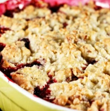 blackberry cobbler with a pecan cookie topping in a casserole dish