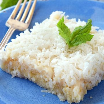 A slice of Coconut Sheet Cake on a plate