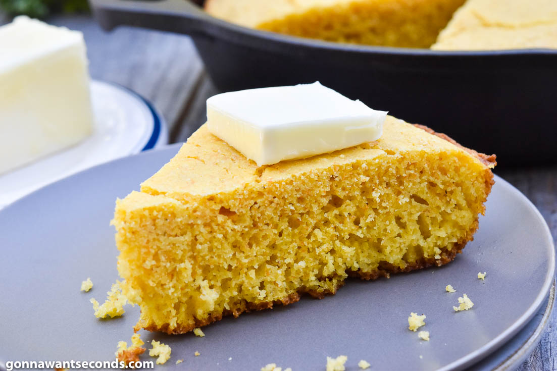 A slice Southern cornbread with butter on top