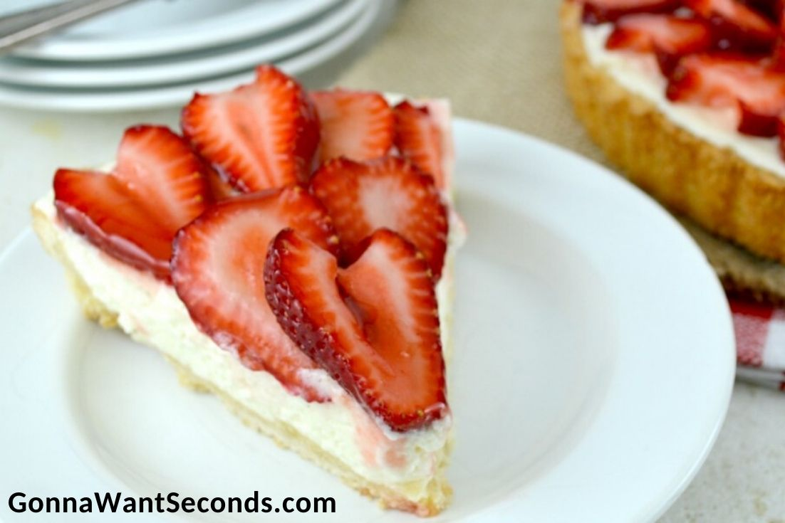 A slice of Strawberry Tart on a plate