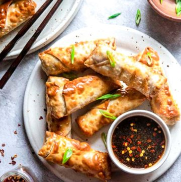 Air Fryer Egg Rolls on a plate with serving sauce