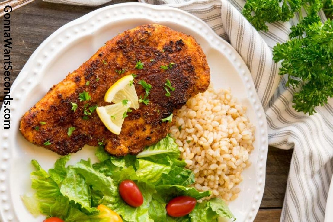 Blackened Chicken with rice and salad on the side