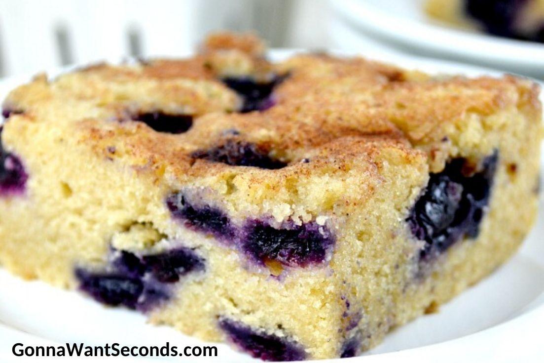 A slice of Blueberry Boy Bait on a plate