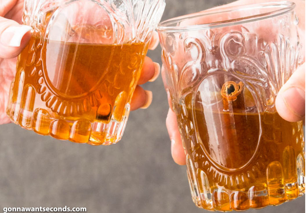 Toasting with two glasses of peach moonshine
