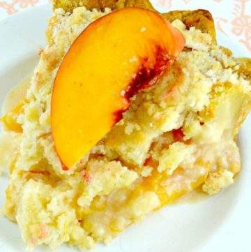 A slice of peaches and cream pie topped with fresh peach
