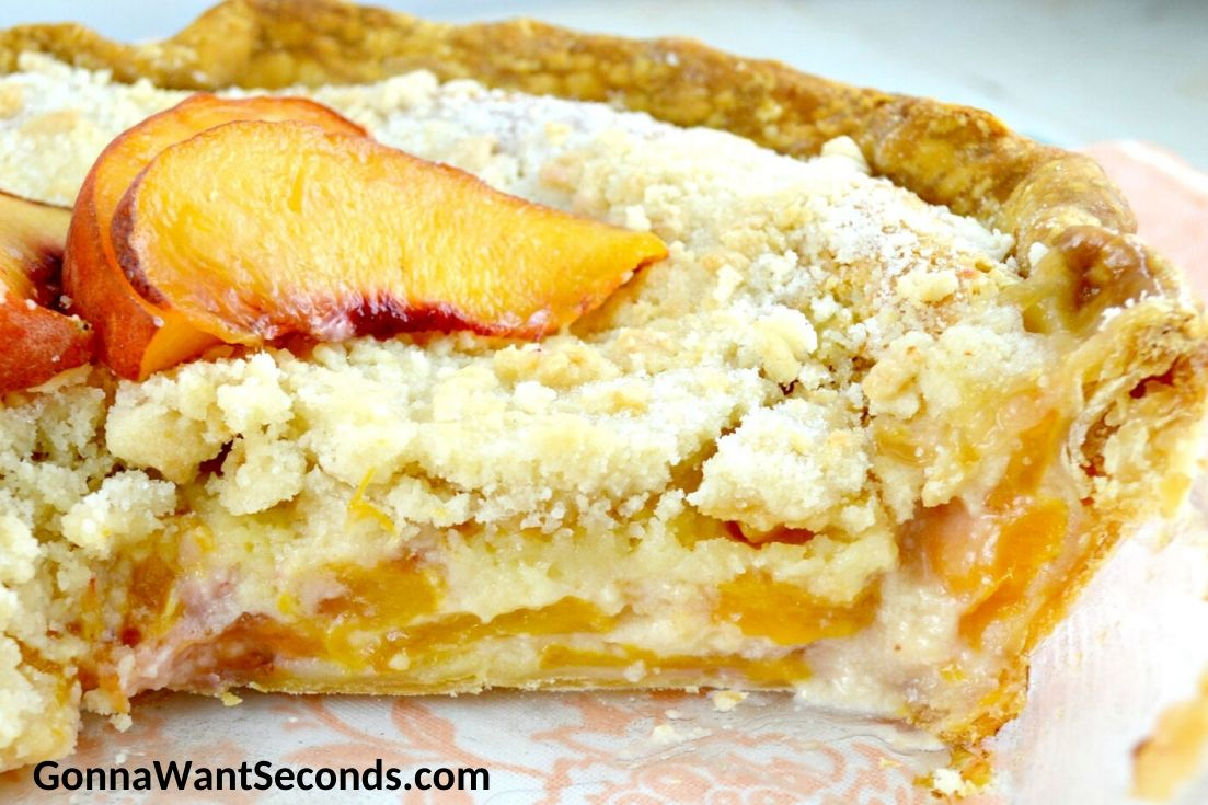 Sliced whole peaches and cream pie showing filling