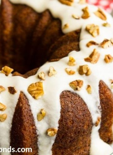 Sock It To Make Cake with glaze and pecans on top
