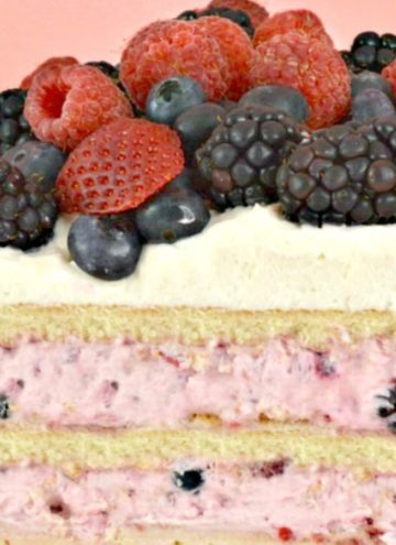 Triple Berry Icebox Cake sliced in half, showing layers