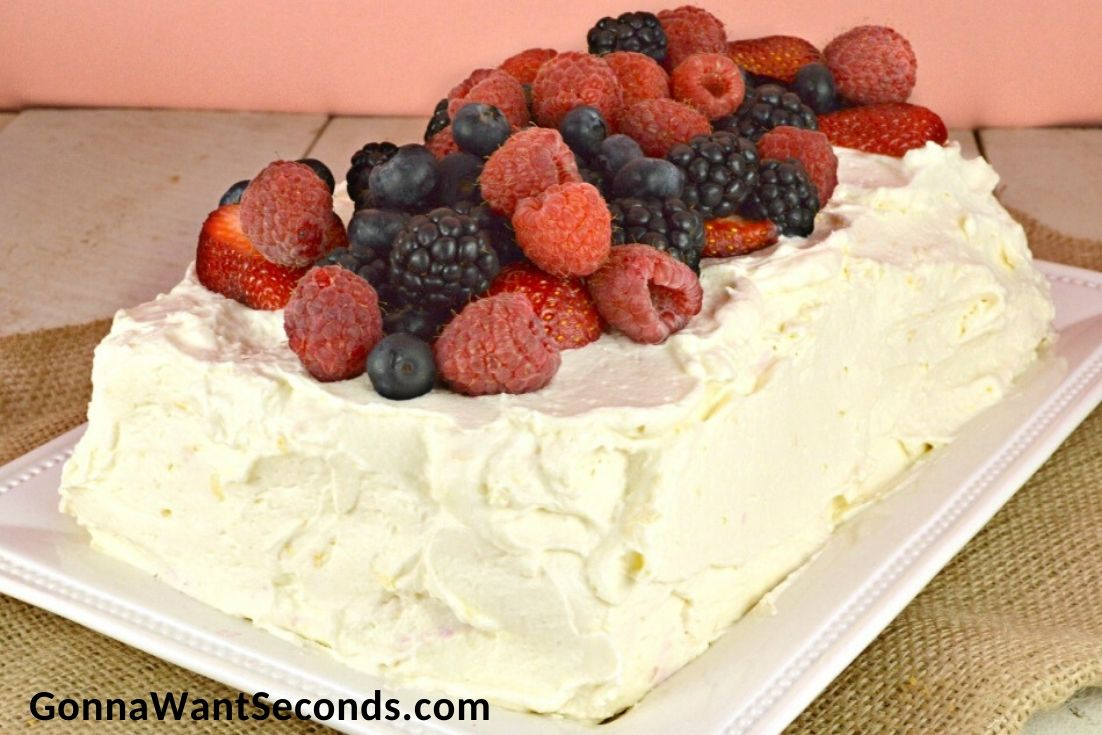 Triple Berry Icebox Cake topped with fresh berries
