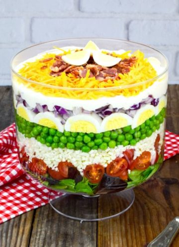7 layer salad in a glass bowl