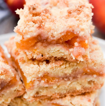 Peach crumb bars stack on top of each other