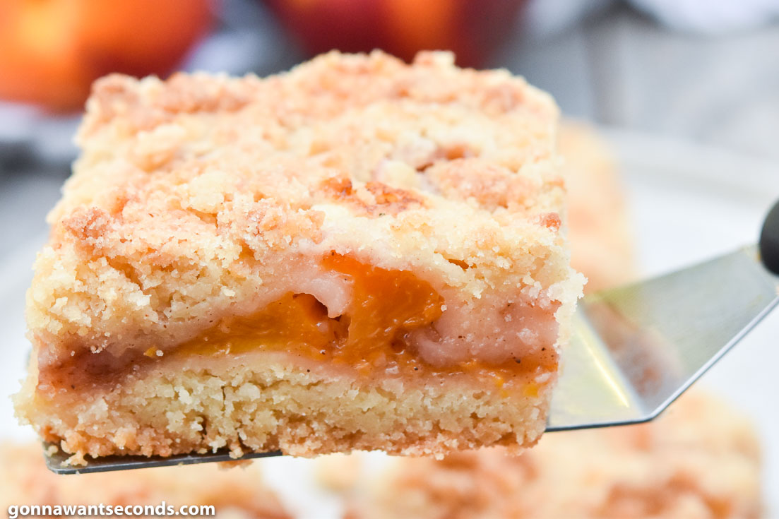 peach crumb bars on a spatula