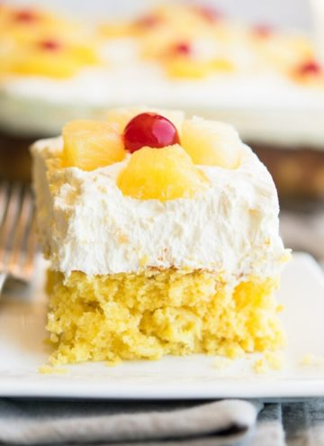 A slice of pineapple sunshine cake on a plate