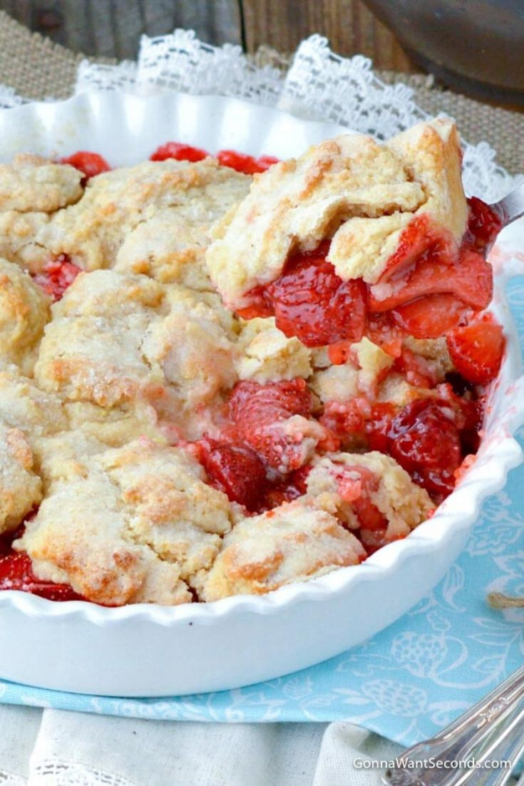 Scooping a portion of Strawberry Cobbler